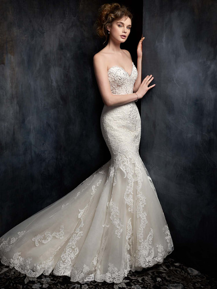 lace mermaid wedding dress with lace hem and beaded bust