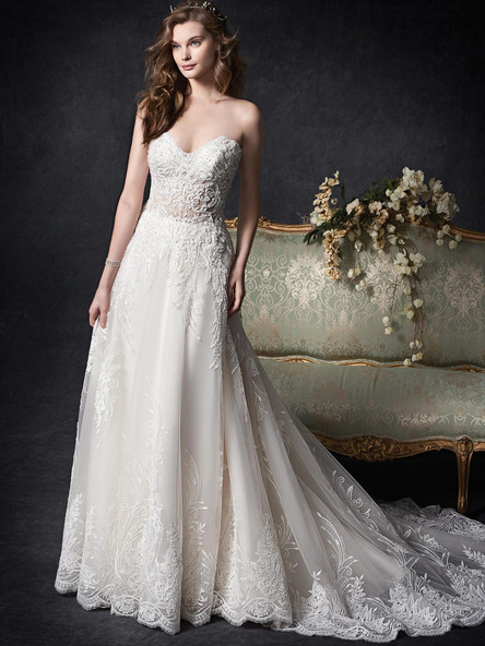 simple lace aline wedding dress with lace trim hem and sheered top