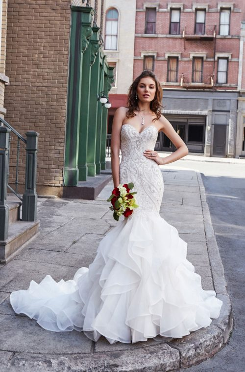 ruffled mermaid style wedding gown sweet heart neckline with beadeds