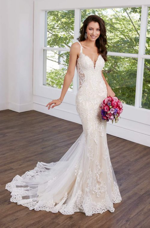 simple lace wedding gown with cutoutsides